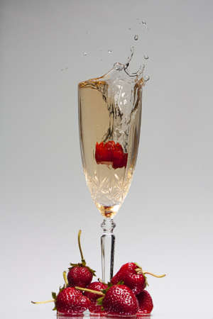 Strawberry dropped in to chrystal champagne flute with splash of champagne