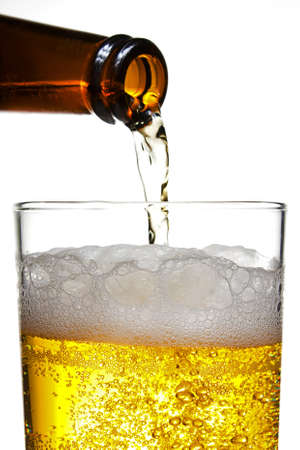 pilsner: Plouring a golden fresh pilsner beer into a straight sided glass