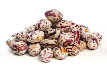 Pile of freshly harvested borlotti beans against a white background Archivio Fotografico