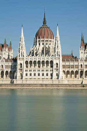 Central portion of the Hungarian parliament building on the blue river danube in Budapest Hungary Stock Photo - 10621680