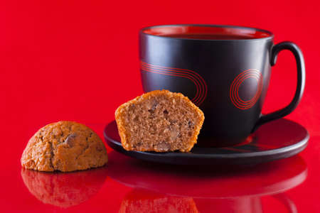 Cup of coffee and freshly baked coffee and walnut muffins photo