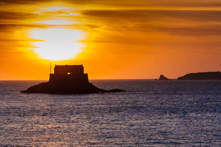 st  malo: Sun setting over the Little Be Fort in St Malo France Stock Photo