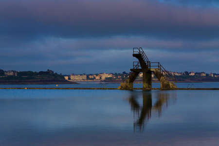 st  malo: Diving board in the sea in St Malo France Stock Photo