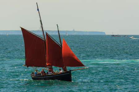 st  malo: Three sail sailing boat at sea in the bay of St Malo in France Stock Photo