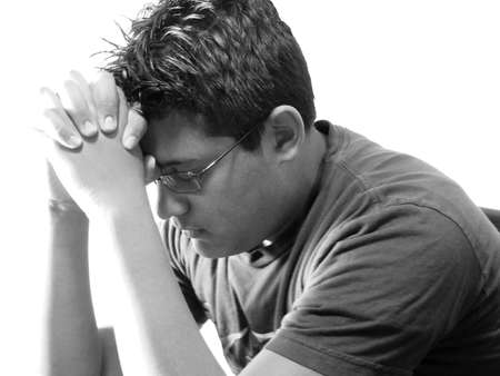 Teenage boy in prayer in black and white
