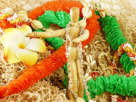 leis: Leis on an artists model and fishing net Stock Photo