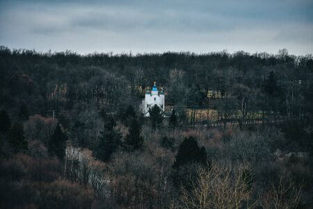 A Shot of a Distant Church in an Isolated Landscape