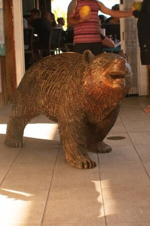 A Shot of a Bear Carved out of Wood