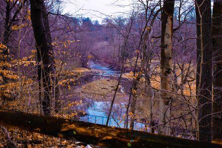 A Shot of an Autumn Landscape With a River Running Through Reklamní fotografie