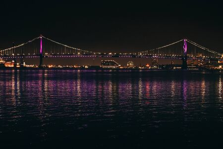 A Beautiful Photograph of the Ben Franklin Bridge, taken at night.