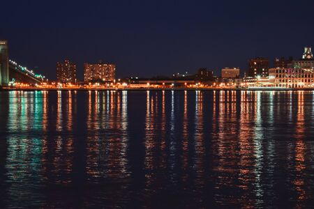 A Photograph of the New Jersey side of the Delaware River taken at night with heavy reflections across it. 스톡 콘텐츠