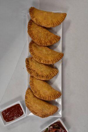 An Overhead Photograph of Freshly Cooked Empanadas 版權商用圖片 - 140271995