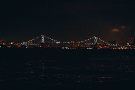 A Shot of a Distant Bridge at Nighttime