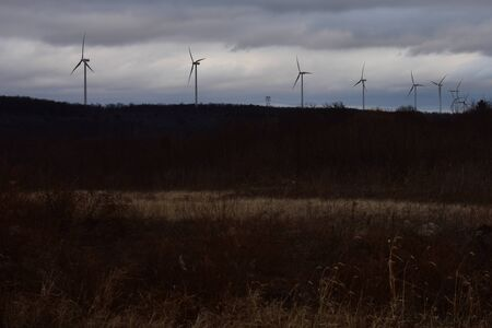 A Shot of a Landscape with Wind Turbines in the Background Stock Photo