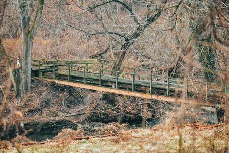 A Shot of an Abandoned Bridge Crossing a River Stock fotó