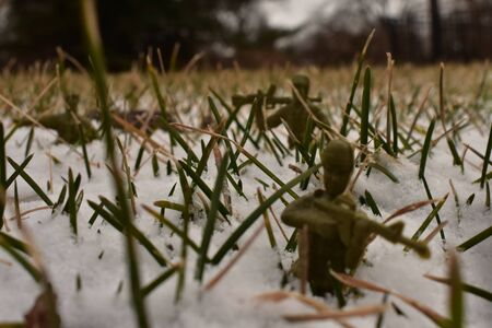 An Image of a Toy Soldiers holding his position in the deep snow. Stock Photo - 141844140