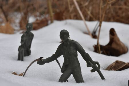 A Close up shot of Toy Army Men marching through the deep snow. Stock Photo - 141843394
