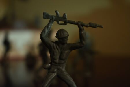 A Shot of a Toy Soldier Preparing to Attack a Target Stock Photo