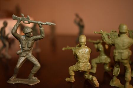 A Close up Shot of Toy Army Men Fighting Each Other.