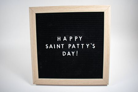 A Black Sign With White Letters That Says Happy Saint Patty's Day on a White Background
