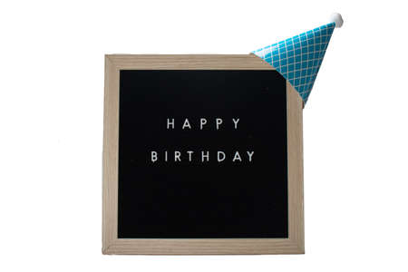 A Black Sign With a Birch Frame That Says Happy Birthday With a Light Blue Striped Birthday Hat and a White Cotton Ball on Top on a Pure White Background 版權商用圖片 - 151568881