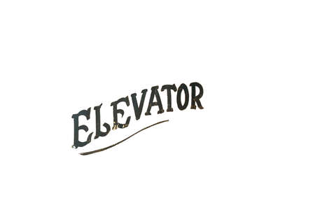 Old Fashioned and Worn Black Text That Says Elevator on a Pure White Background 版權商用圖片 - 151916905