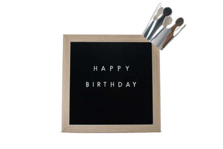 A Sign With a Birch Frame That Says Happy Birthday in White Letters With a Silver Crown on top on a Pure White Background 版權商用圖片 - 151826078
