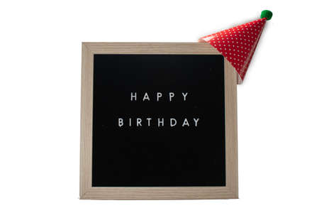 A Birch Framed Sign That Says Happy Birthday in White Letters With a Red Party Hat on Top on a Pure White Background