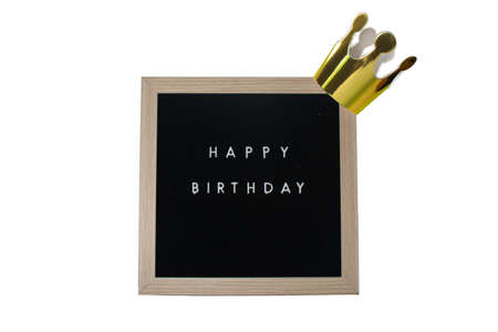 A Sign With a Birch Frame That Says Happy Birthday in White Letters With a Gold Crown on top on a Pure White Background 版權商用圖片 - 151825647