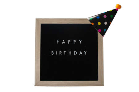 A Birch Framed Sign That Says Happy Birthday in White Letters With a Black Party Hat on Top on a Pure White Background