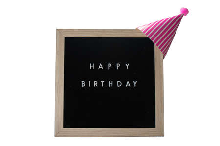 A Birch Framed Sign That Says Happy Birthday in White Letters With a Pink Party Hat on Top on a Pure White Background