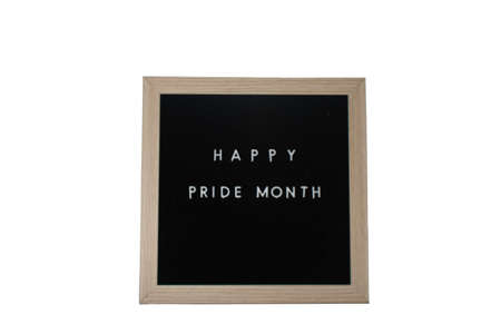 A Black Sign With a Birch Frame That Says Happy Pride Month in White Letters on a Pure White Background