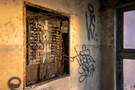 An Old and Rusty Electrical Panel in an Abandoned Building 版權商用圖片
