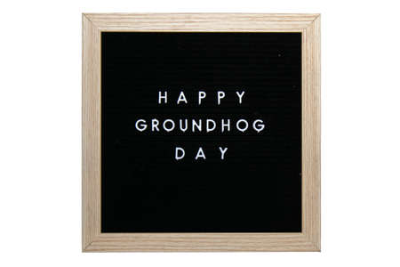 A Black Sign With a Birch Frame That Says Happy Groundhog Day in White Letters on a Pure White Background