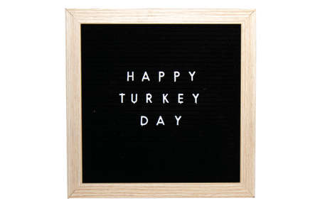 A Black Sign With a Birch Frame That Says Happy Turkey Day in White Letters on a Pure White Background