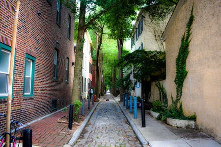 A Cobblestone Allway in the City of Philadelphia with Brick Buildings on Each Side