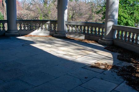 A Large Balcony Floor Covered in Dead Orange Leaves at Elkins Estate