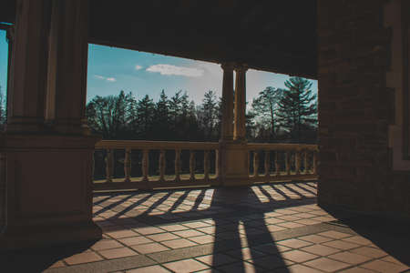 A Gorgeous Balcony at the Elkins Estate With a View of Trees and a Clear Blue Sky