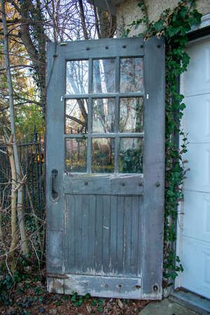 An Old Wooden Door With Glass Windows on an Antique Garage in Suburban Pennsylvania