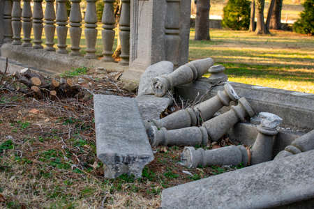 An Ornate and Detailed Borken Concrete Fence Laying in the Grass at Elkins Estate