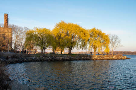Looking Over a Small PArt of the Deleware River at Green Trees in Sunset Light at the Newly Renovated Penn Treaty Park