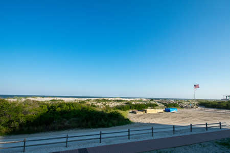 The Beach With a Wooden Fence and Sand Dunes Covered in Plants in Wildwood New Jersey 스톡 콘텐츠