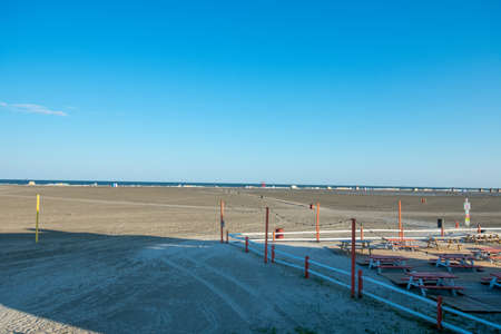 A View of the Wildwood Beach and the OCean With Park Benches and a Fence 스톡 콘텐츠
