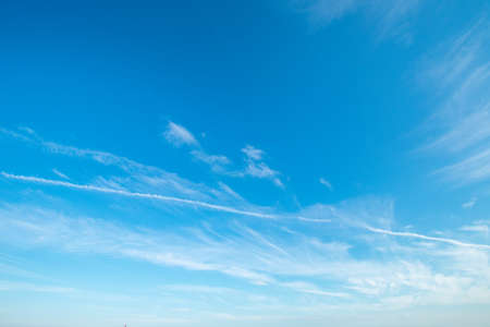 A Gorgeous Clear Blue Sky With Clouds and Contrails for Sky Replacement
