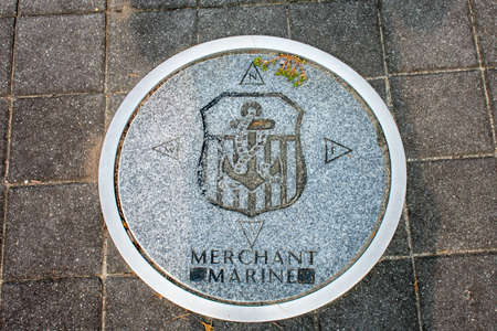 WILDWOOD, NEW JERSEY - September 16, 2020: A Circular Symbol Representing The US Merchant Marines on the Ground. 報道画像