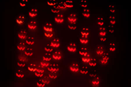 Orange Jack O' Lantern Shaped Bokeh on a Black Background