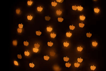 Yellow Apple Shaped Bokeh on Black