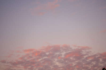 A Blue Sky With Pink Clouds at the Bottom of the Frame