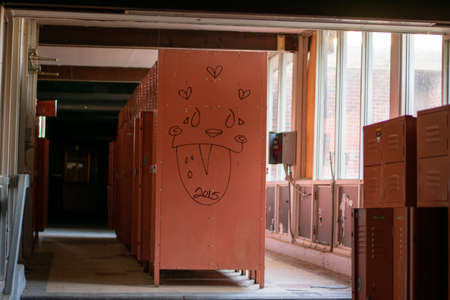 A Locker Room With Red Lockers in an Abandoned School
