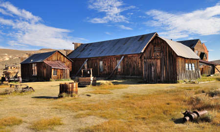 Old houses and barn in Bodie State Historic Park  Bodie is a vey well preserved ghost town in California, USA